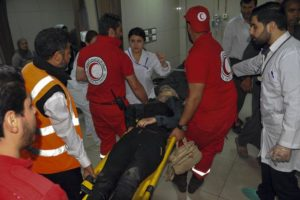 Syrians wounded receive first aid after alleged morter attack by Jaysh al-islam on Damascus