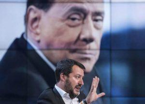 Matteo Salvini. Sullo sfondo Silvio Berlusconi.