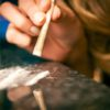 Young woman snorting cocaine with rolled up dollar