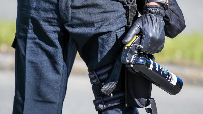 epa06793706 A police officer holds a can of pepper spray while facing protestors during the G7 Summit in Quebec City, Quebec, Canada, 08 June 2018. Leaders of the US, Canada, France, Germany, Japan, Italy, the United Kingdom as well as the European Union gather for the G7 Summit, which runs from 08 to 09 June in Charlevoix, Canada. EPA/TANNEN MAURY