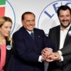 (L/R): Giorgia Meloni, President of Brothers of Italy party, Silvio Berlusconi, Leader of Italian right-wing party Forza Italia (Go Italy) and Northern League leader Matteo Salvini pose upon arrival at the Tempio di Adriano in Rome on March 1, 2018. Silvio Berlusconi's rightwing coalition, which is on course to win the most votes in Italy's election, is holding its first and last public meeting on March 1, in an attempt to quell speculation of severe internal divisions. Berlusconi, the flamboyant 81-year-old former prime minister and head of the centre-right Forza Italia (Go Italy), and the leaders of far-right parties the League and Brothers of Italy (FdI), Matteo Salvini and Giorgia Meloni, have not once met publicly in the entire election campaign. / AFP PHOTO / Alberto PIZZOLI